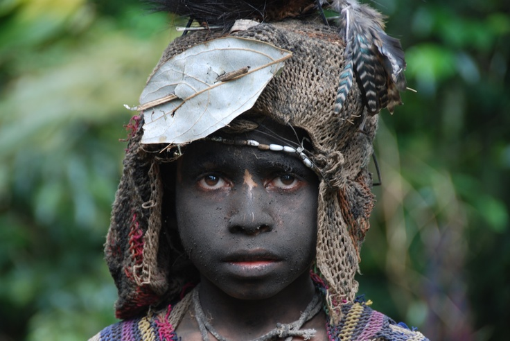 Those eyes. Papua New Guinea rich in history and tradition.