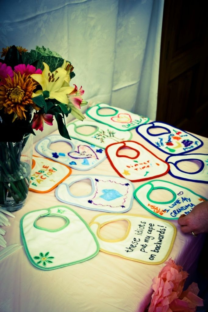 **baby shower game: Get fabric pens and each guest personalizes a bib for the baby. I think these will work: http://www.bedbathandbeyond.com/store/product/green-sprouts-reg-by-i-play-reg-10-pack-stage-2-3-terry-cloth-bibs-for-girls/1015021519
