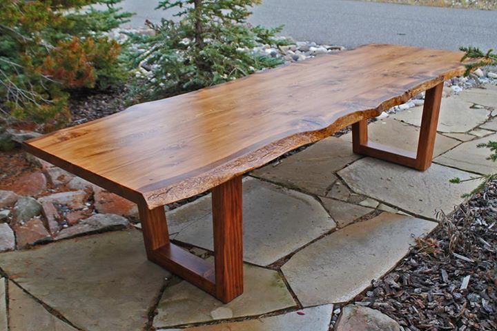 This breathtaking dining table features a top that is almost 3 inches thick and includes the bark-stripped living edge of the original tree. These beetle-killed Douglas Fir trees are harvested and milled only after they've fallen naturally. We kiln-dry these pieces for over three months before using them to build your furniture.