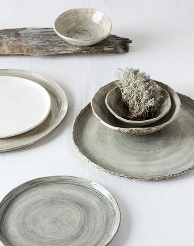 the simplicity of the plates and the use of drift wood & moss for photo