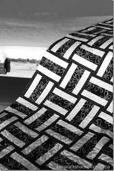 Pedal to the Metal it's the narrow strips on either side of the rails that make this quilt exceptional