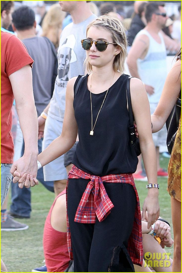Emma Roberts and Evan Peters go hand-in-hand at Coachella