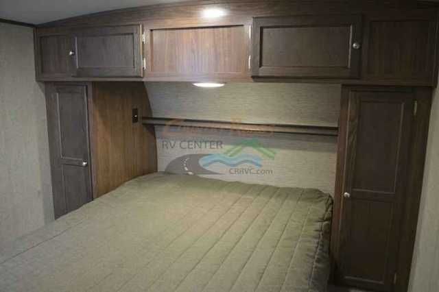 """2016 New Forest River Palomino Solaire Eclipse 247RKES Travel Trailer in North Carolina NC.Recreational Vehicle, rv, 2016 Palomino Solaire 247RKES - Rear Kitchen, Triple Slide, This brand new plan has 3 slides in a 28' trailer! Entertainment center w/ a 39"""" TV that can be viewed from outside as well. Tri-fold sofa that pulls out to a king bed. Private bathroom with glass shower enclosure and a queen master bed. Weighs 5,600 lbs. Sleeps 4.-.-.-.-.-.-. Options Included: Value Package, Eclipse…"""