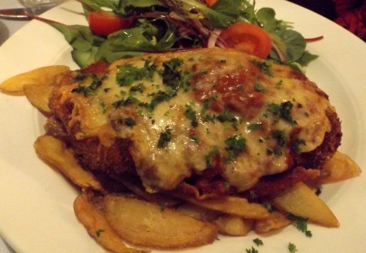 Chicken Parmagiana; Fresh ingredients, house made sauce, hand cut chips and fresh as you like garden salad...Yum!