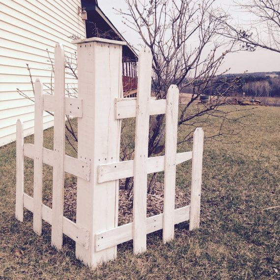 This decorative garden corner picket fence is made from for Pallet picket fence