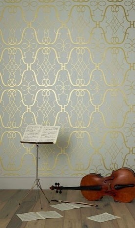 Gold patterned wallpaper.