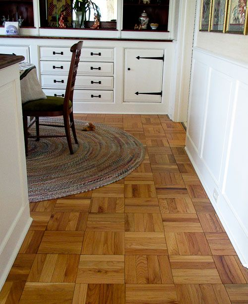 wood parquet floors. original to my 1951 colonial-modern ranch. The parquets are each 12″ wide
