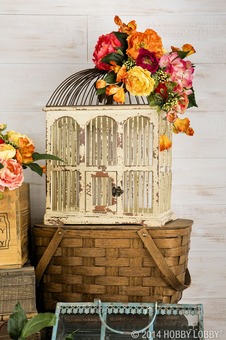 Add faux flowers to a birdcage for a bright burst of spring indoors!