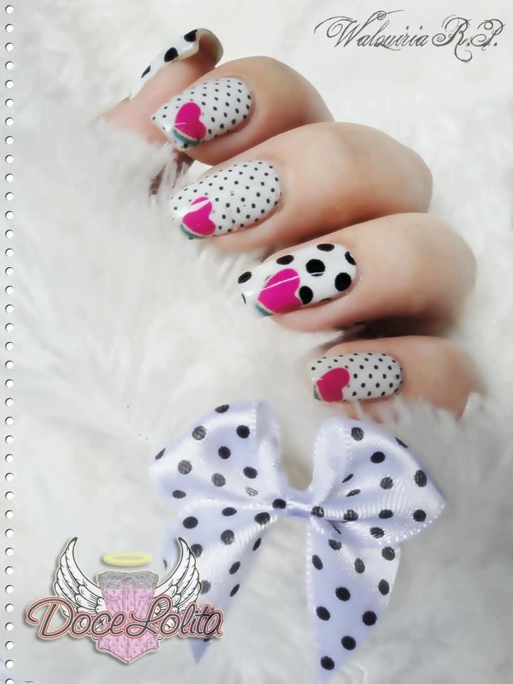 White Nails with big & small black polka dots & a single fuschia heart nail art