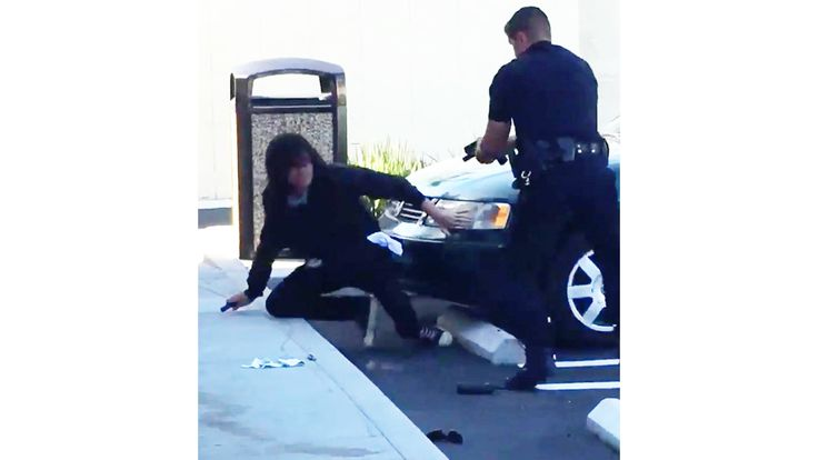 A Huntington Beach police officer was captured on video Friday morning shooting a man outside a 7-Eleven.