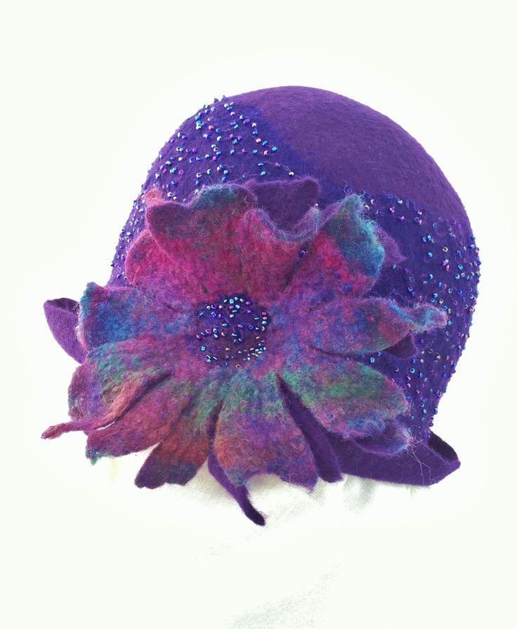 Purple nuno-felt hat with integrated flower by Dawn Edwards of Felt So Right. www.feltsoright.com