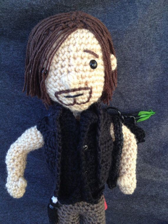 Daryl Dixon fights zombies in The Walking Dead and now can fight them in your own home! Daryl is handmade in a smoke free no pet home. He is made