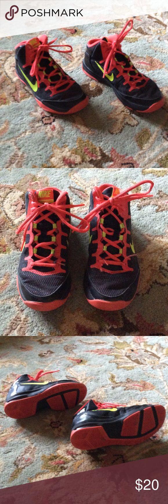 Nike hi tops Awesome Nike hi tops!  Black with orange trim and neon yellow swoosh.  Worn one season for basketball. Nike Shoes Sneakers