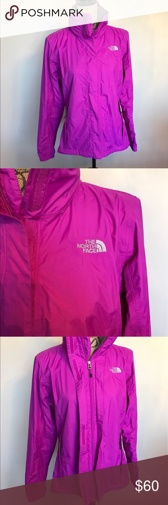 North face rain jacket w/hood or tuck it in Worn once🎉 Please ask for additional pictures, measurements, or ask questions before purchase. 🎉 No trades or other apps 🎉 Ships next business day, unless noted in my closet  🎉 Bundle for discount North Face Jackets & Coats