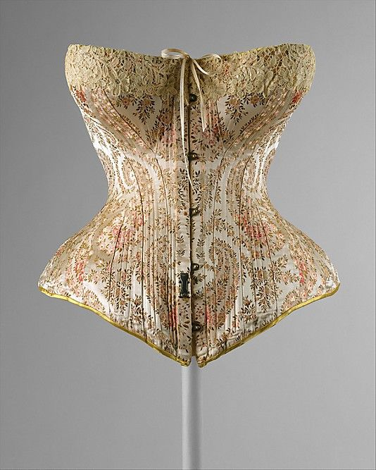 """Corset, Maison Léoty (French): 1891, French, silk. """"In the eighteenth century, the corset imposed a more-or-less conical configuration to the upper torso. By the late nineteenth century, a more softly rounded female form was preferred. This extended even to the body in profile. The straight and rigid busks of the eighteenth century gave way to busks that not only curved into the waist but also rounded out over the belly."""""""