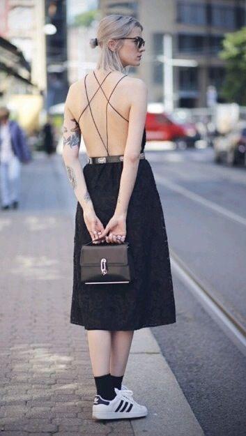 Street style   Edgy black open back midi dress, sneakers, handbag