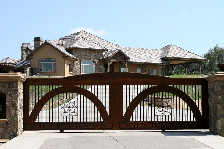 Wood and iron slide gate system. Designed, built and installed by Rising Star Industries. This gate is located in Murrieta, CA. We are southern Californias leading automatic gate installers. Automatic gates in southern California. Driveway gates, security gates, electric gates, wrought iron gates, property security, swing gates, slide gates & vertical lift gates. We also do masonry columns, custom wrought iron front doors and window coverings. ...