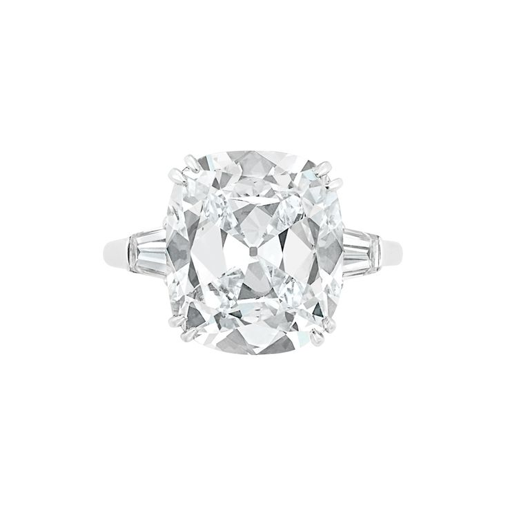 Diamond Ring, Harry Winston  Platinum, centering one cushion-cut diamond approximately 5.68 cts., flanked by two tapered baguette diamonds, signed Winston.