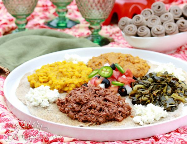 How to Make an Ethiopian Feast! Ethiopian Recipes: Doro Wat and Injera Recipe. All the fragrances and flavors of Ethiopian Recipes on one big platter. Slow