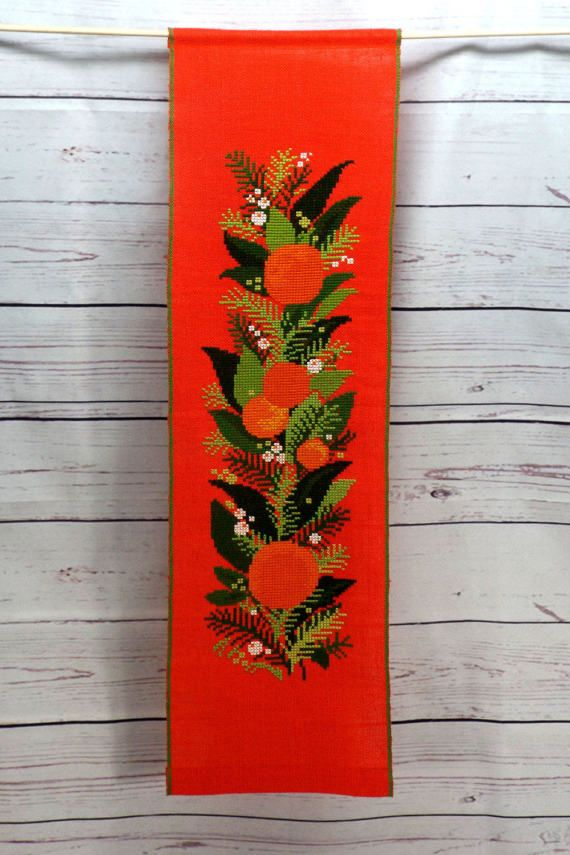 Retro wall hanging with embroidered fruits. Mercerized cotton yarn cross stitch embroidery on coral red linen. Around 1970s. With two pockets for rods, top and bottom. Measures 26.5 x 7.75 (67 x 20 cm) Wt 0.12 lbs (55 g) + wrapping Condition: In a very good vintage condition with no