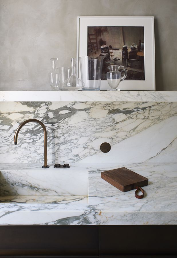 marble countertop and matching floating shelf.