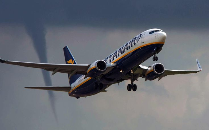 A tornado follows this Ryanair fight as it takes off from Eastmidlands airport on route to Palma Mallorca Spain