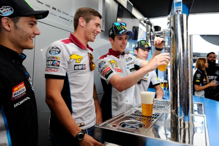 Alex Marquez pouring beer, Estrella Galicia Marc VDS hospitality opening, Spanish MotoGP 2015