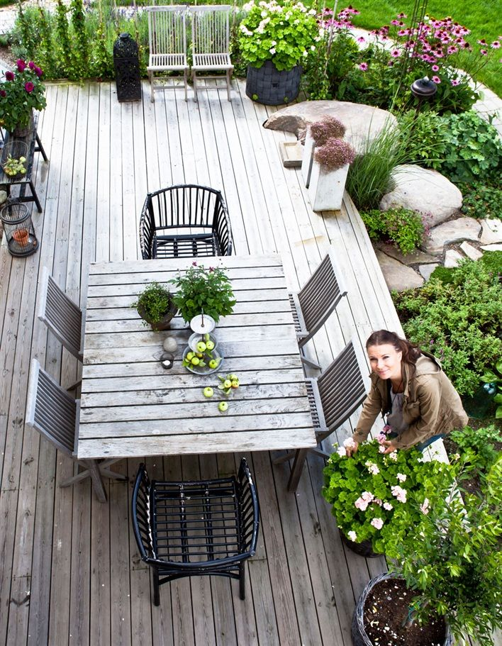 I would love to landscape the crap out of the space around our patio, a lot like this!