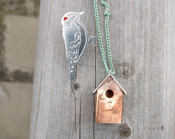 "Mixed Metal Birdhouse with the Downy Woodpecker Pin! This hand-fabricated necklace is 1"" tall. It is made out of copper and silver, on an enamel-coated 32"" brass chain. The birdhouse is lightly heat treated for a weathered look."