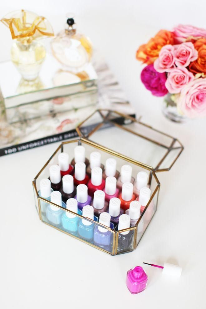 Beauty Product Organization: 10 Chic Ways to Decorate Your Vanity - nail polish in a decorative glass box—organized by color, and in the company of pink roses