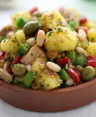 A rustic Spanish potato salad with chunks of tuna, white beans, colorful peppers and green olives tossed in a richly-flavored olive oil, red vinegar and smoked paprika dressing.