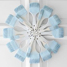 Paint brushes arranged in a circle. Creative 'snowflake' wreath--idea from the craft design team at Lowe's