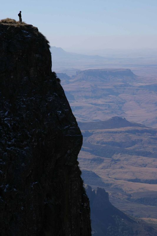 In the Drakensburg mountains, South Africa. 3000 foot drop on top of the Amphitheater.