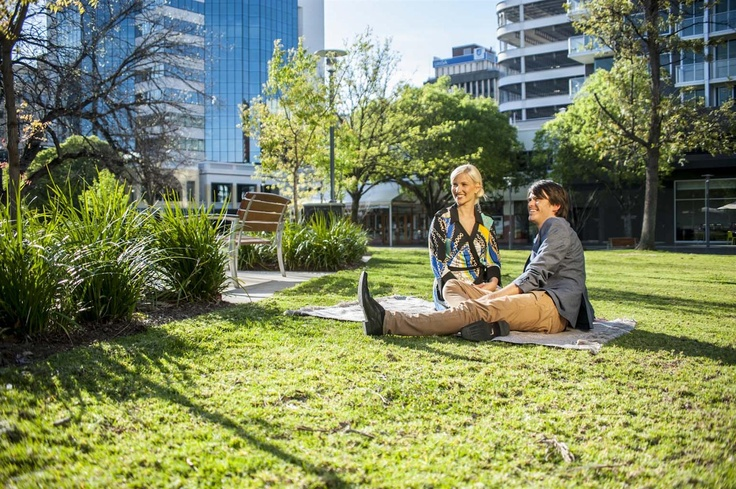 Relaxing on the grass outside Crowne Plaza Adelaide.