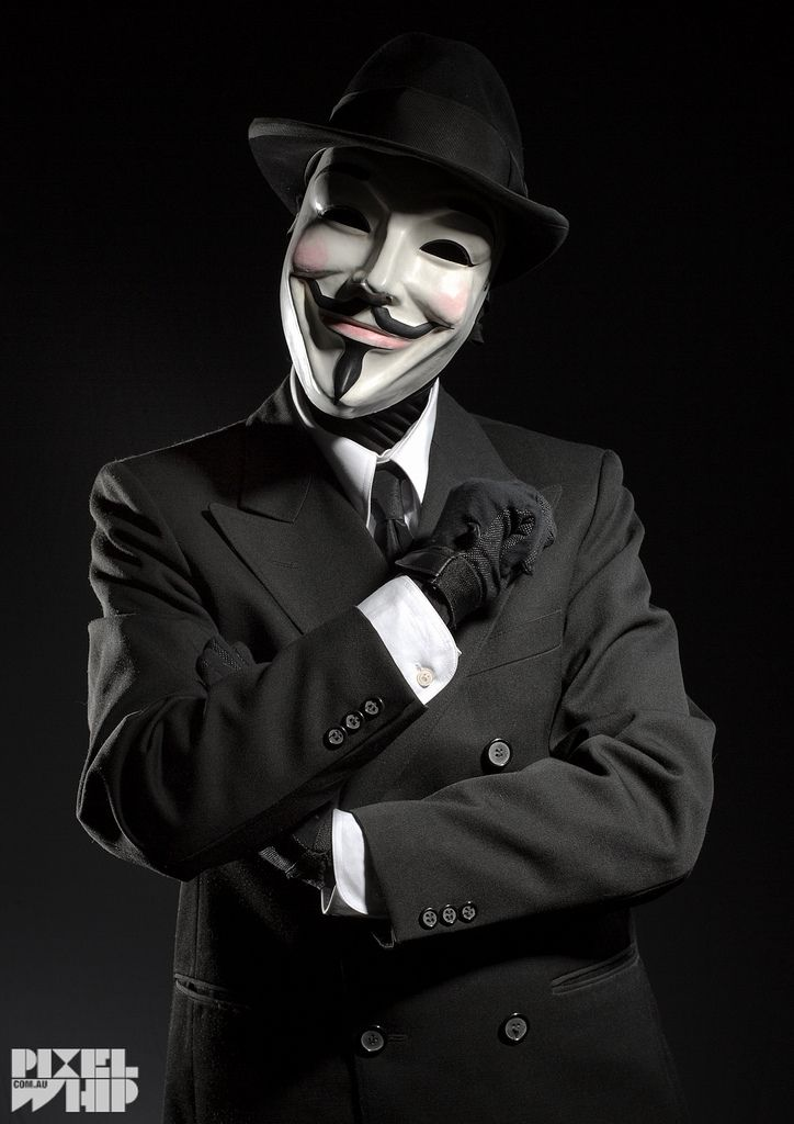 https://flic.kr/p/eSD2Wg | MAN IN anonymous mask in business suit | A shot of a man dressed in a suit wearing an anonymous mask shot in dark moody film noir low key studio lighting. a mysterious anti corporate business hacker type or a protester to save the world with new ideas?