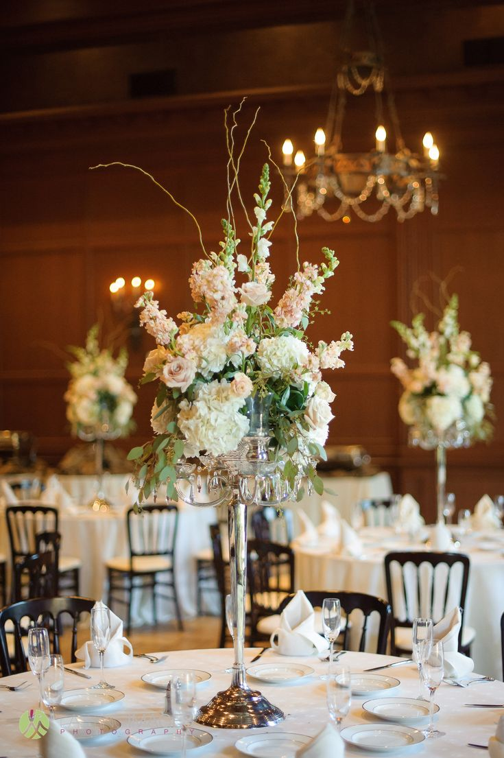 Tall silver candlabra centerpiece with white shaps, peach stock, white hydrangeas, roses and eucalyptus | Lasting Images Photography | villasiena.cc