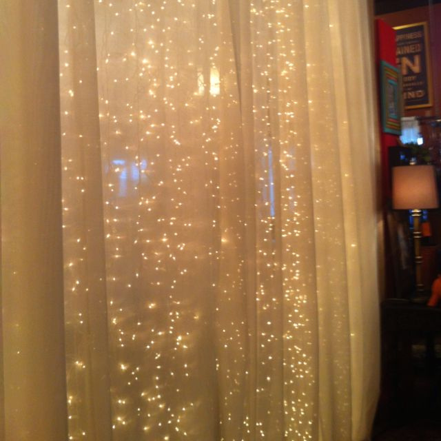 Room divider using icicle lights and a really thin sheer fabric. So pretty!
