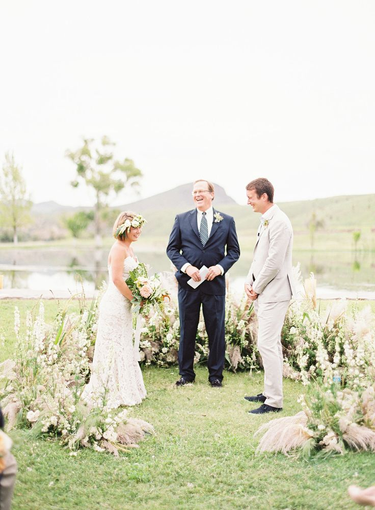 Native grass arch installation by bows and arrows flowers. Marfa Texas. Photography: Kayla Barker Fine Art Photography - www.kaylabarker.com Read More: http://www.stylemepretty.com/2015/06/19/rustic-romance-at-cibolo-creek-ranch/
