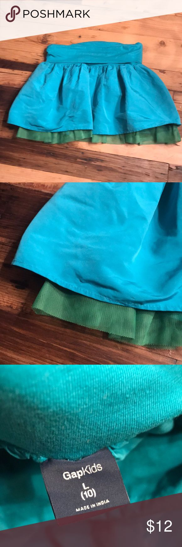 Gap skirt turquoise and green Large Gap Kids Taffeta like material with a peek of green tulle at the bottom. Waist is a stretch cotton to add to comfort. GAP Bottoms Skirts