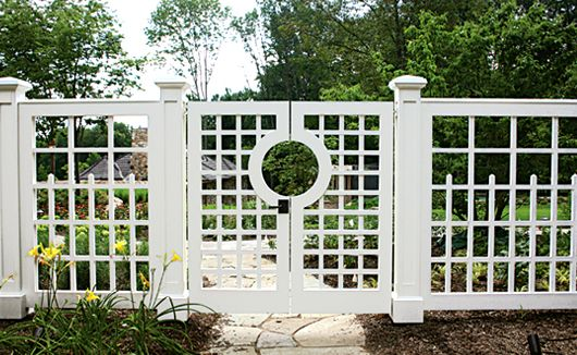 Modify design for privacy trellis/gate at end of driveway into side deck area.