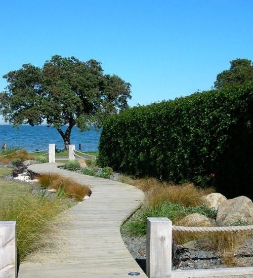 Coastal garden - planting and board walk Love the rope and fence post