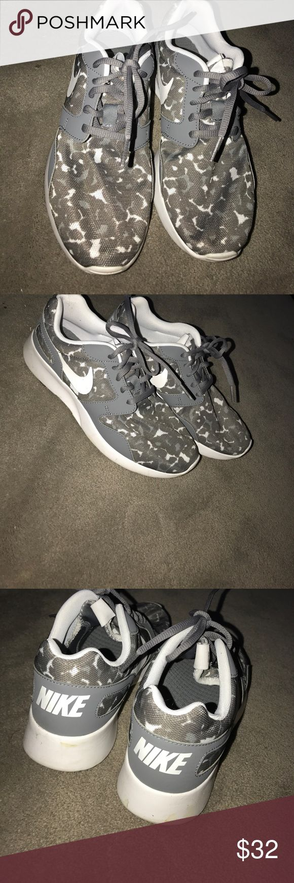 Cheetahs print Nike running shoes Super cute Nike running shoes grey and white cheetah print worn once no stains one slight dirt mark on heel which can be washed off. Offers always welcomed Nike Shoes Sneakers