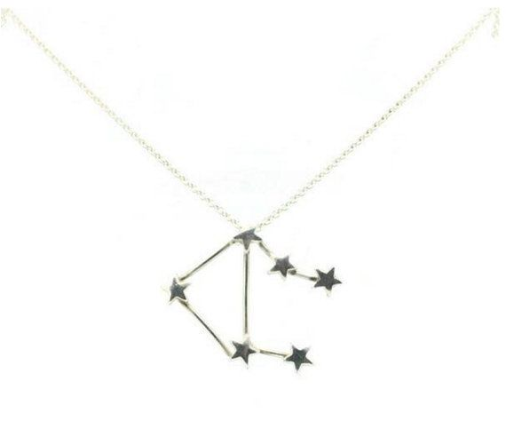 For birthdays between October 21st - November 20th  The Scorpio constellation necklace features tiny hand forged stars suspended by a delicate link chain.  Made from recycled silver and finished with a fine lustre. Available in an oxidised vintage finish upon request.   Made to order (1-2 weeks) Fine silver and 925 sterling silver hardware 20 inch sterling silver chain Comes gift boxed Handmade in England Style it with: Perfect alone with plunging necklines or layered up with our other…