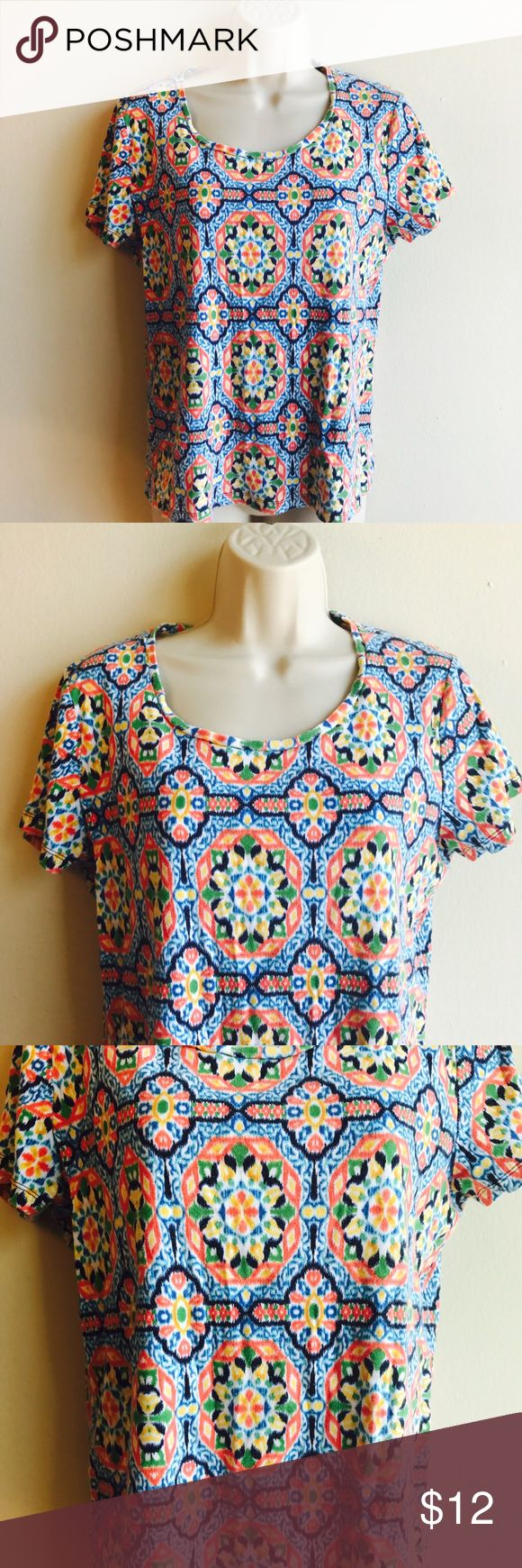 Jones New York Multi Color Shirt Beautiful multi color geometric print shirt 👚 tag says Xl but it fits like a loose small or a fit medium. In good condition. Bundle to save more. No trades. Jones New York Tops Tees - Short Sleeve