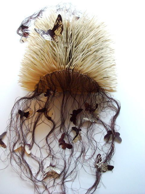 sculptural artist book by Louise Tett – the pages cut to fan out like fur, the hair acting as a net for butterflies.