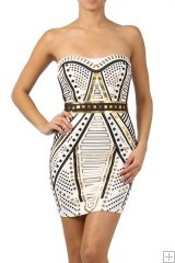 # 3331  95% Polyester 5% Spandex  S/M/L   Beige   This HIGH QUALITY dress is BEAUTIFUL! Made from a soft and stretchy fabric, this studded, body-con, mini dress with a boat neckline, contrast metallic binding, and an open back is hand washable, and fits true to size.80