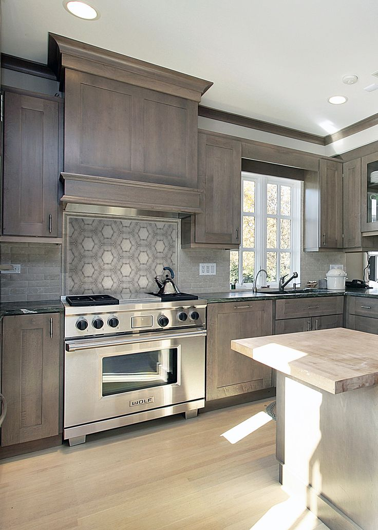 """The new """"Encore Hexagon Tile"""" is featured on a stunning natural stone and can go on the floor of your kitchen or as a backsplash on your wall.  The choice where you want to use this modern design is up to you!"""