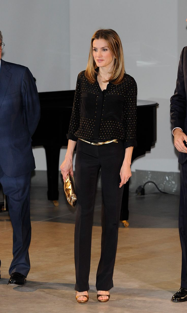 Attention to detail made Letizia's look pop at an event in Madrid in May 2012. Her all-black separates got a cool contrast with a dose of go...