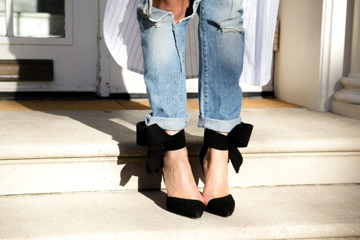 Bow suede pumps with distressed boyfriend jeans.