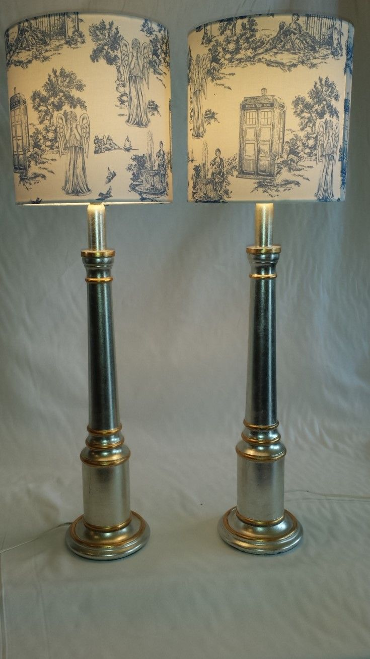 So French - so calming. I love this pair of new blue Toile shades on these silver and gold painted wooden lamp bases. They stand 79cms from table to top of shade - we will sell separately.